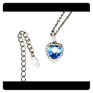 Diamond/blue topaz pendant set in sterling silver.
